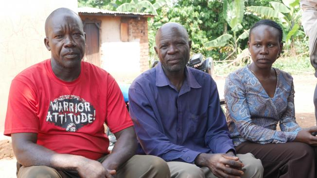 Three smallholder clients on a bench